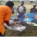 women roasting fish during the ACWW wORLD pRESIDENT VISIT WOmen roaating fish